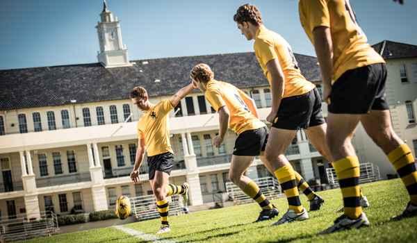 Scots boys kicking rugby ball