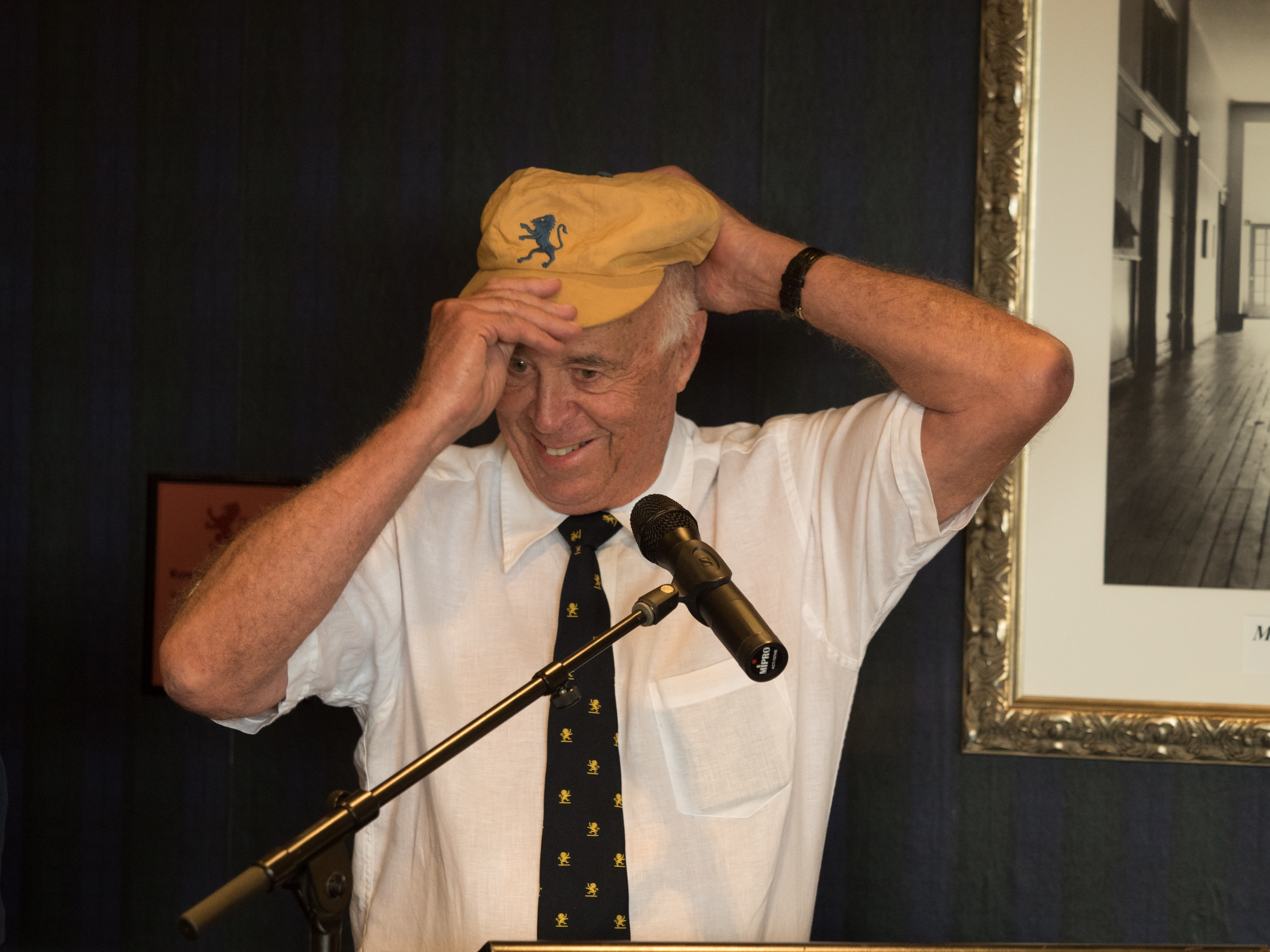 Peter Howarth OAM wears a Cricket cap
